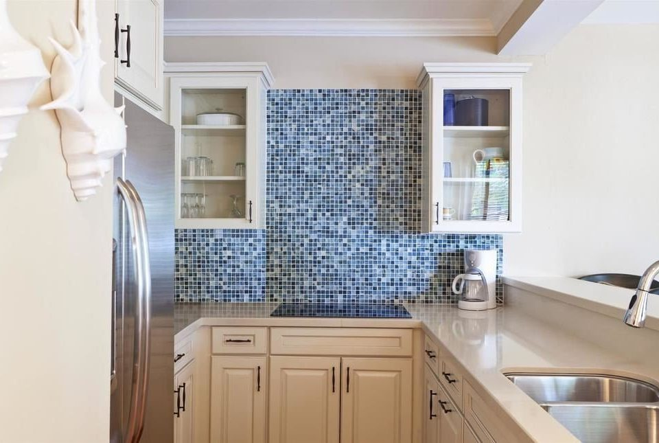 cabinet Kitchen property bathroom home cabinetry hardwood cottage countertop flooring appliance kitchen appliance