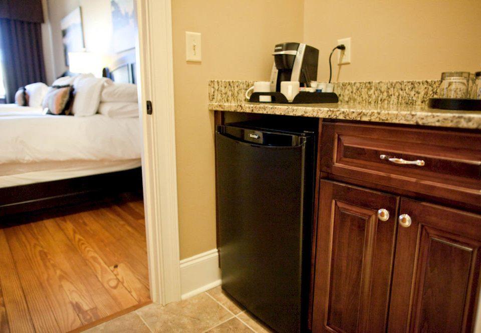 cabinet Kitchen property cabinetry countertop bathroom hardwood home flooring wood flooring cottage laminate flooring appliance kitchen appliance