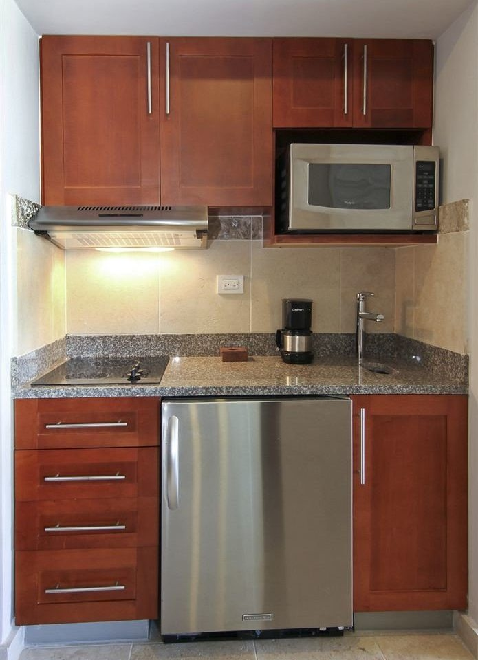 cabinet Kitchen property cabinetry countertop kitchen appliance cuisine stainless cuisine classique hardwood appliance steel sink food counter bathroom cabinet microwave stove silver oven