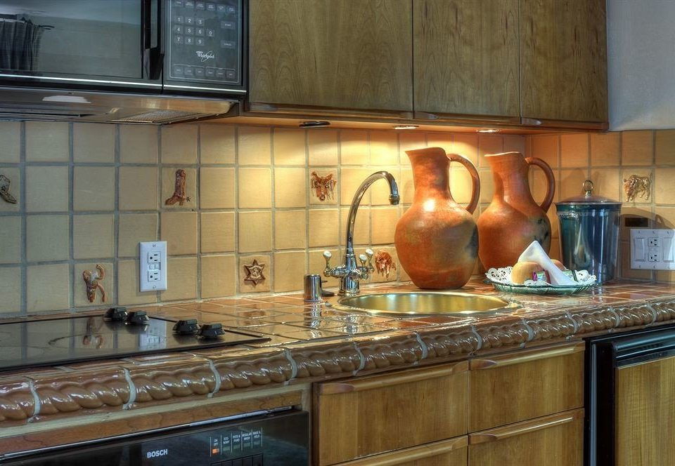 cabinet Kitchen property countertop cabinetry home hardwood counter cuisine classique cottage food appliance material kitchen appliance microwave stove