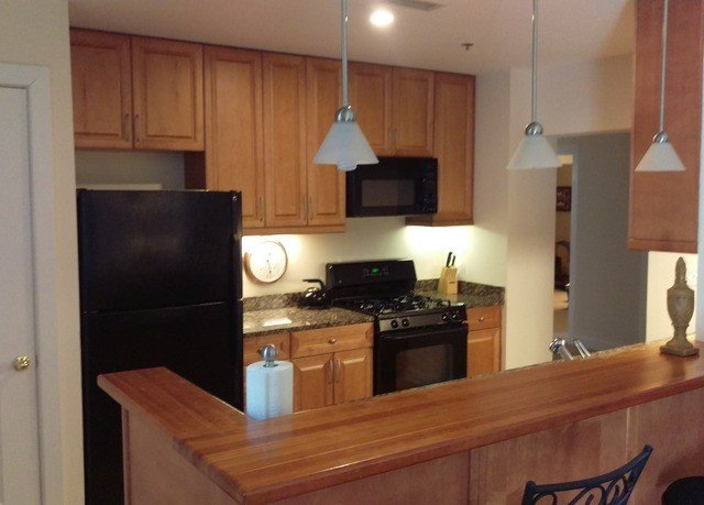 cabinet Kitchen property cabinetry countertop home hardwood cottage cuisine classique appliance stainless steel