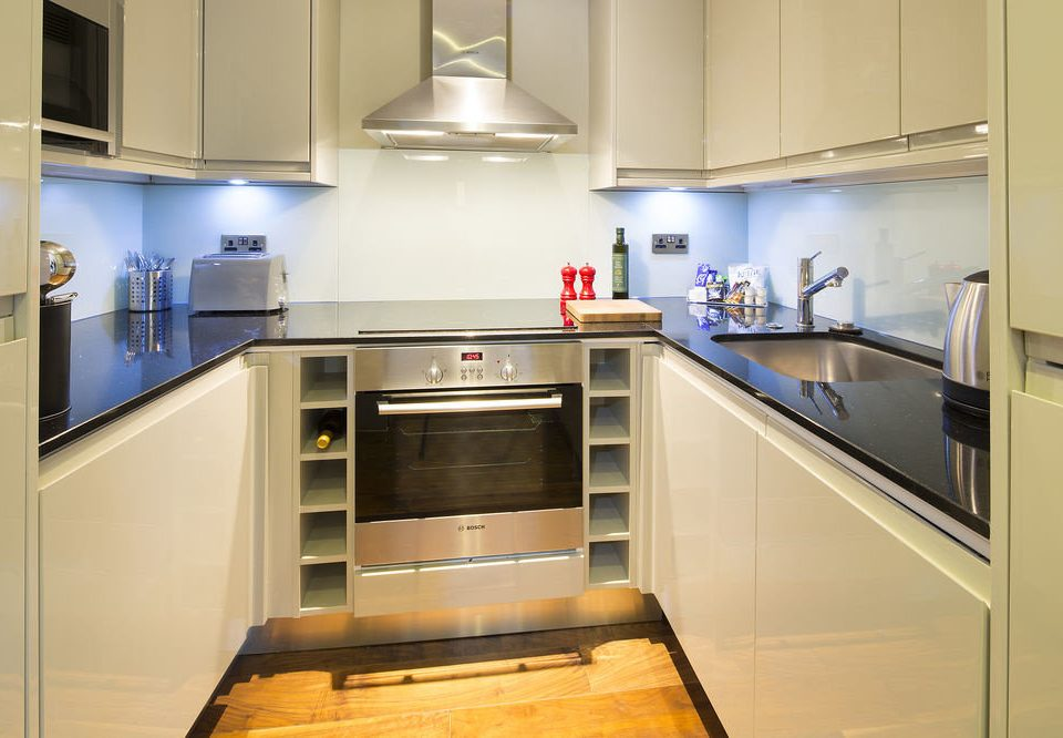 cabinet Kitchen property cabinetry home cuisine classique countertop stainless cuisine steel appliance kitchen appliance