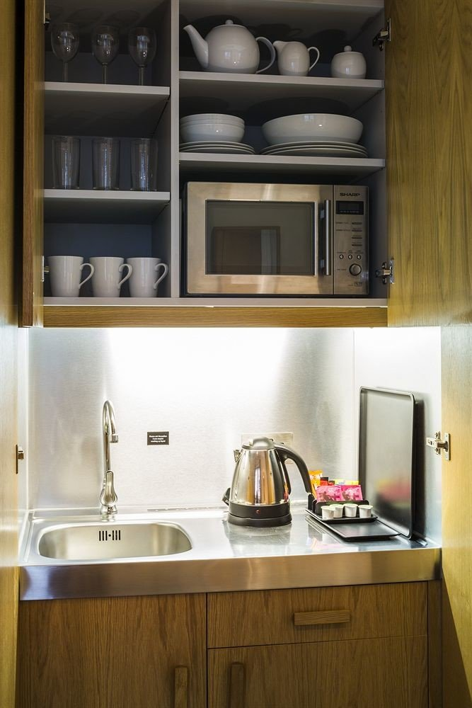 cabinet Kitchen cabinetry home countertop microwave cuisine classique shelf living room appliance kitchen appliance