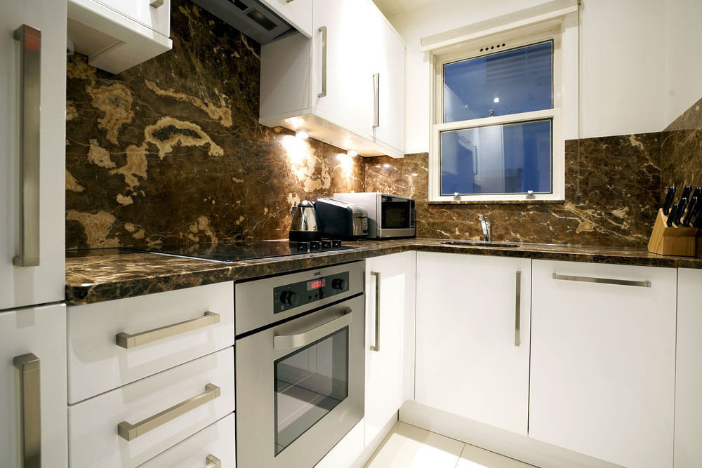 cabinet Kitchen property white home oven countertop cabinetry stove cottage cuisine classique cuisine kitchen appliance appliance