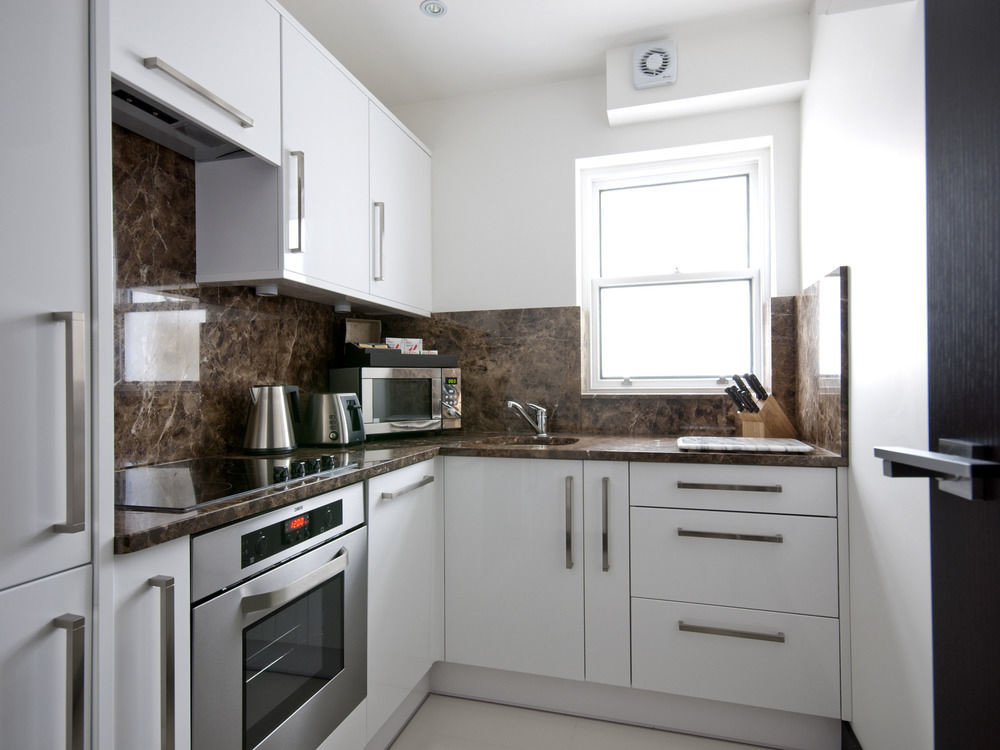 cabinet Kitchen property white cabinetry home cuisine classique appliance cottage stove countertop cuisine counter kitchen appliance