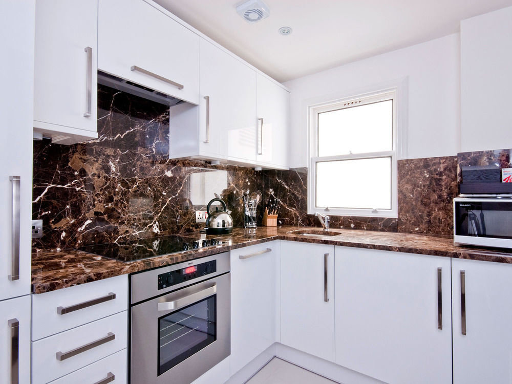 cabinet Kitchen property home stove countertop oven cabinetry kitchen appliance appliance cuisine classique hardwood cottage