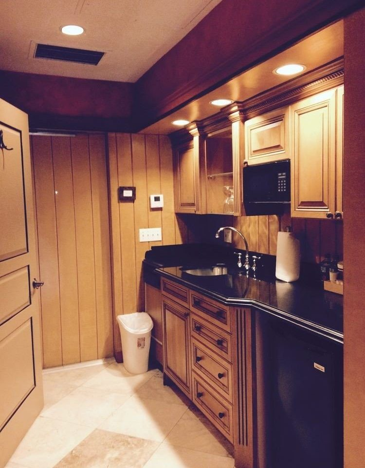 cabinet Kitchen property cabinetry home countertop hardwood cottage appliance