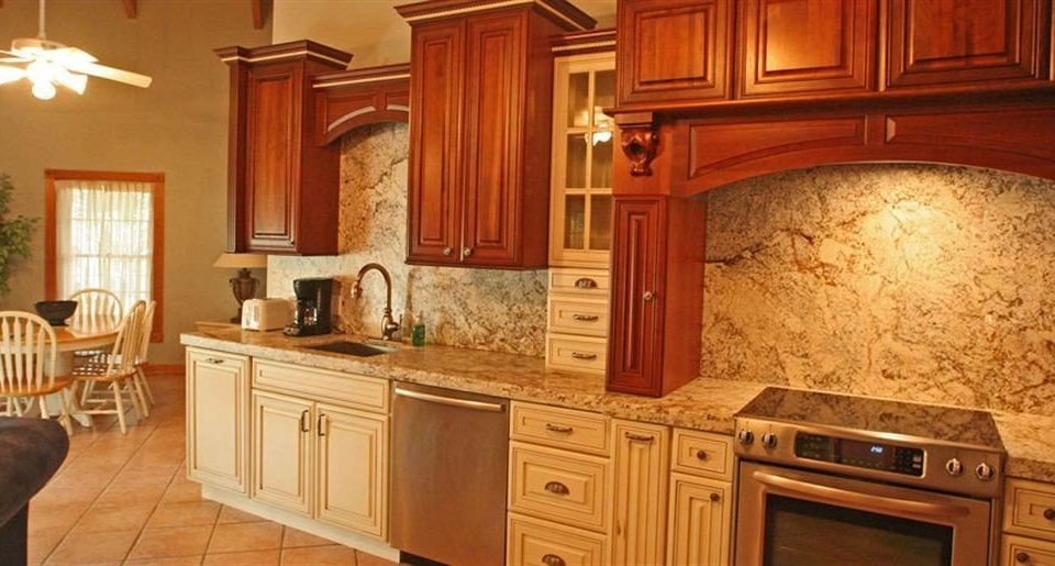 cabinet Kitchen property countertop cabinetry hardwood home cottage cuisine classique wood flooring farmhouse flooring appliance wood stain material