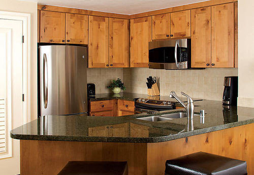 cabinet Kitchen countertop property cabinetry wooden hardwood home cuisine classique appliance counter kitchen appliance wood flooring material stainless steel microwave
