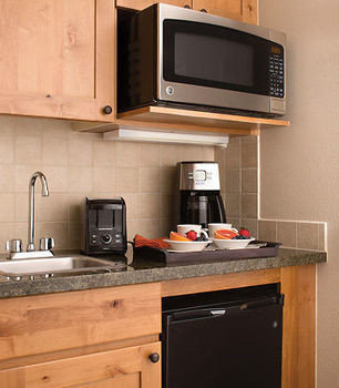 cabinet Kitchen countertop cabinetry microwave hardwood home cuisine living room appliance kitchen appliance stove