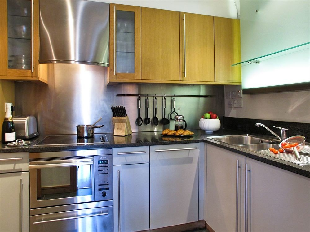 cabinet Kitchen property countertop cabinetry home cuisine classique cuisine kitchen appliance appliance stainless steel stove