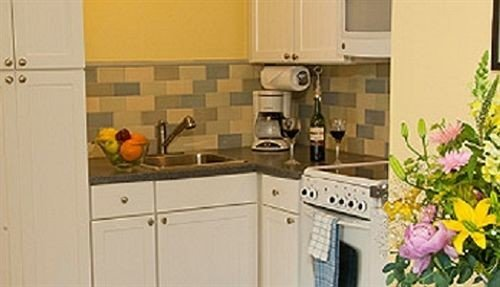 cabinet Kitchen property home countertop cottage white cabinetry appliance flooring kitchen appliance stove