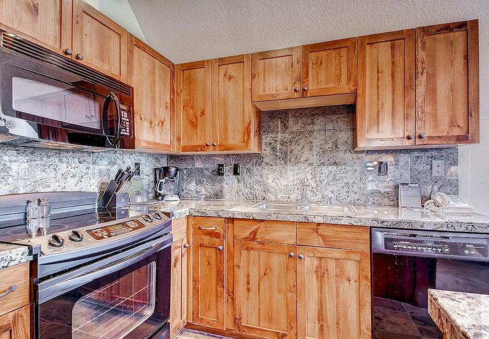 cabinet Kitchen wooden property countertop cabinetry house home hardwood cuisine classique cottage cuisine material appliance kitchen appliance
