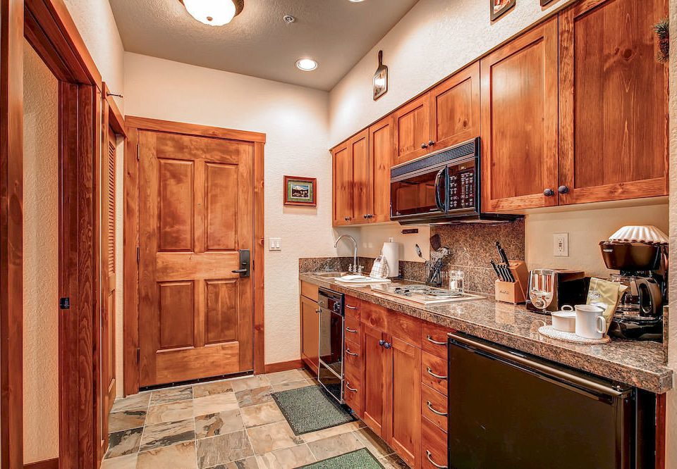 cabinet Kitchen property cabinetry home hardwood wooden cuisine classique countertop cottage counter appliance farmhouse flooring wood flooring