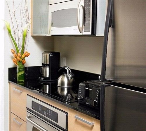 cabinet Kitchen kitchen appliance stainless steel cabinetry home countertop stove shelf appliance oven silver microwave