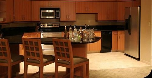 cabinet Kitchen property hardwood cabinetry home cottage appliance kitchen appliance