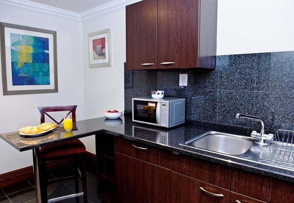 cabinet Kitchen property home countertop cabinetry hardwood cuisine classique cottage counter appliance