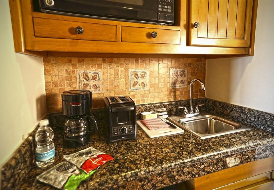 cabinet Kitchen counter countertop home appliance cabinetry sink kitchen appliance cottage material stove