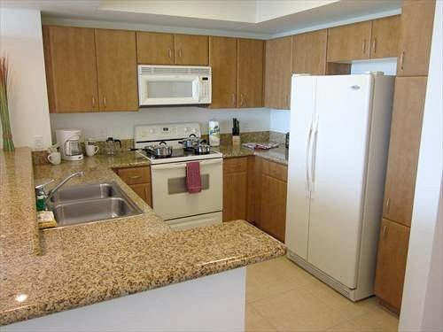 cabinet property Kitchen sink countertop home counter cottage hardwood cabinetry flooring appliance