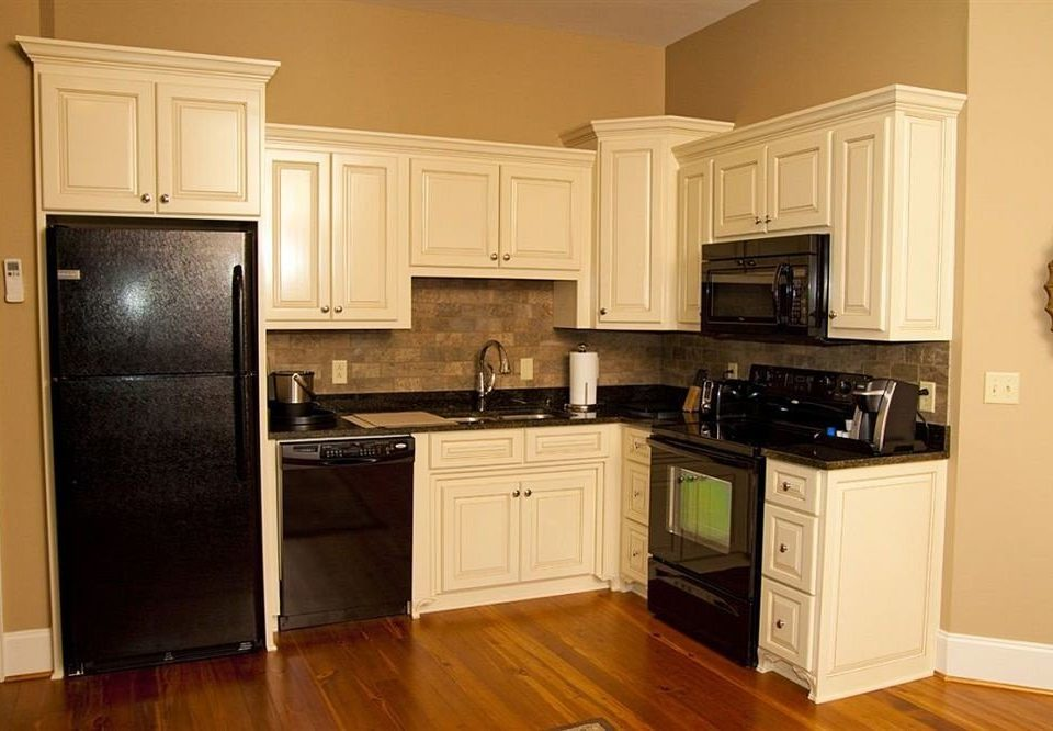 cabinet Kitchen property cabinetry countertop home hardwood appliance cuisine classique wood flooring flooring cottage kitchen appliance