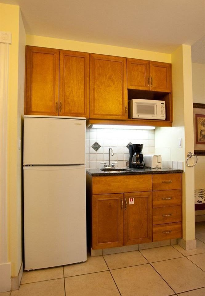 cabinet Kitchen refrigerator property cabinetry hardwood home appliance cupboard cottage flooring wood flooring kitchen appliance