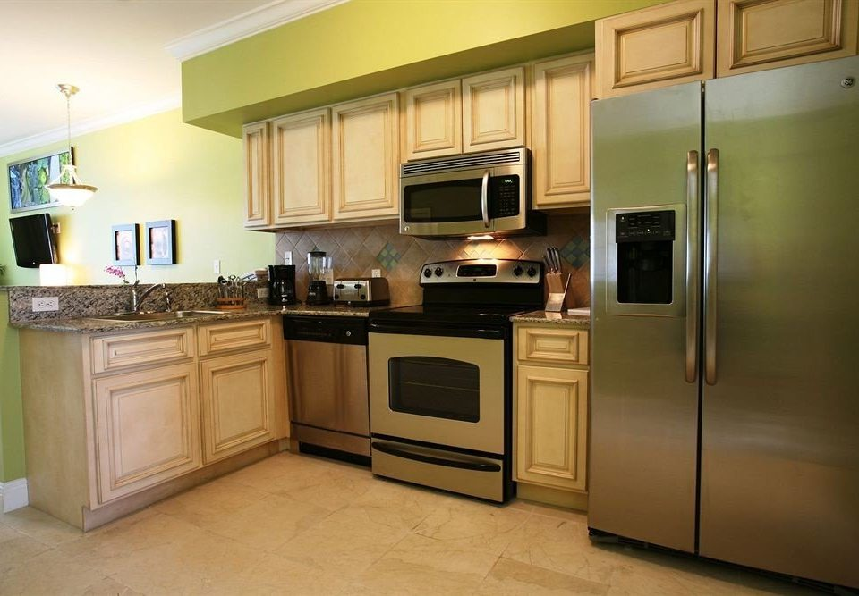 cabinet Kitchen property cabinetry stainless appliance home steel kitchen appliance cuisine classique hardwood cuisine cottage countertop silver microwave oven stove