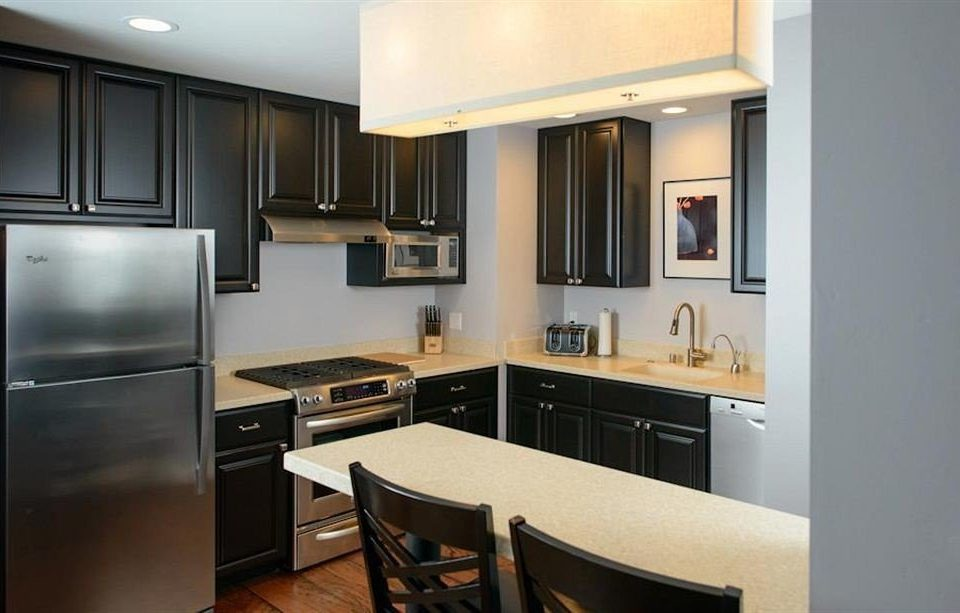 cabinet Kitchen property cabinetry home cuisine classique countertop hardwood stainless condominium cottage kitchen appliance steel appliance silver