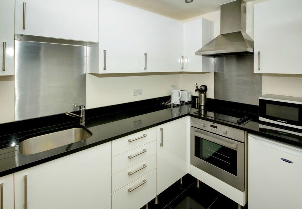 cabinet Kitchen property countertop white cabinetry stove home cuisine classique cuisine kitchen appliance appliance counter material
