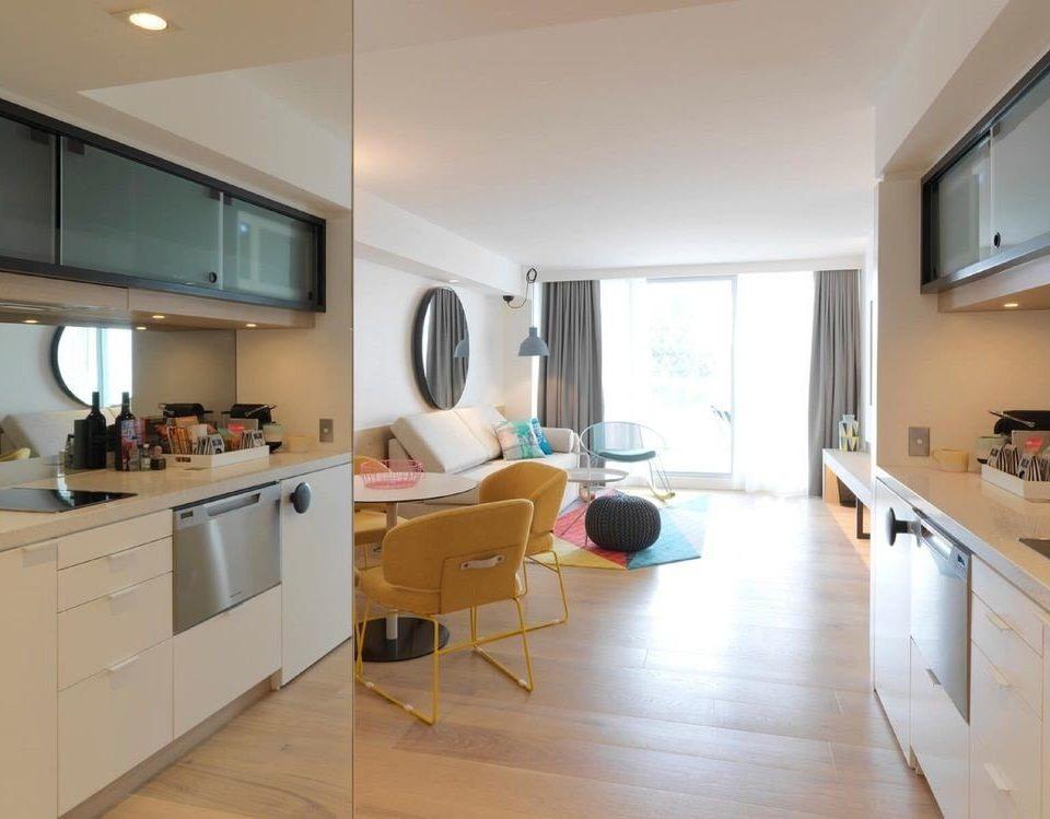 cabinet Kitchen property white home condominium hardwood cottage living room loft appliance kitchen appliance stove