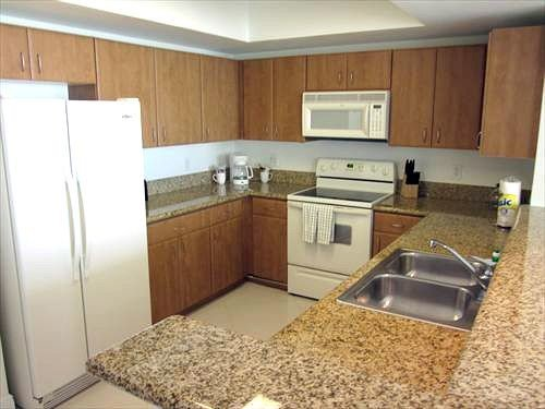 cabinet Kitchen property countertop cottage counter appliance travel trailer vehicle flooring stainless kitchen appliance