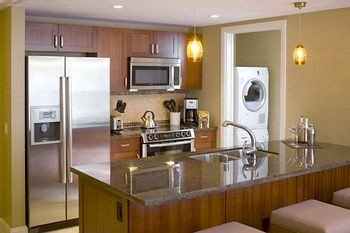 property Kitchen cabinetry home sink cuisine classique cottage countertop condominium stainless steel appliance