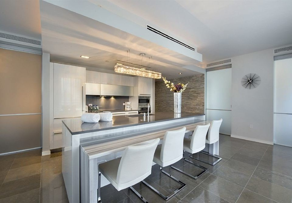 property Kitchen home hardwood white condominium cabinetry countertop living room appliance