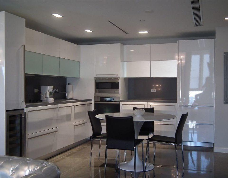 Kitchen property living room cabinetry home hardwood cuisine classique lighting countertop condominium appliance
