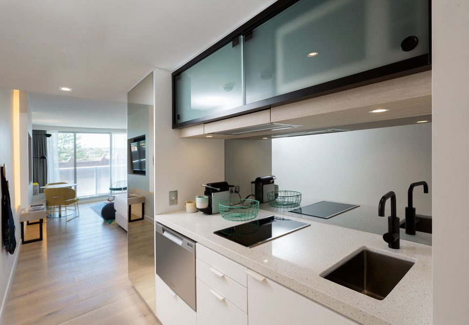 Kitchen property home condominium living room daylighting cabinetry appliance stainless