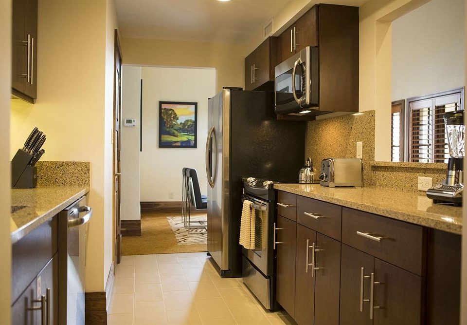Kitchen sink property cabinetry home counter hardwood cuisine classique countertop cottage condominium stainless appliance steel