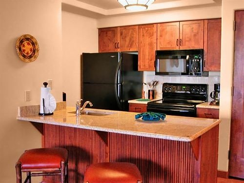 Kitchen property cabinetry home hardwood living room cottage countertop cuisine appliance
