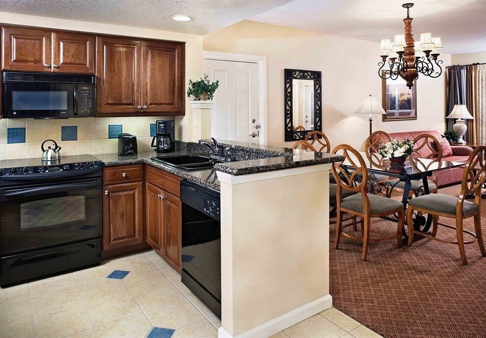 Kitchen property home cabinetry hardwood cottage cuisine classique living room countertop appliance kitchen appliance