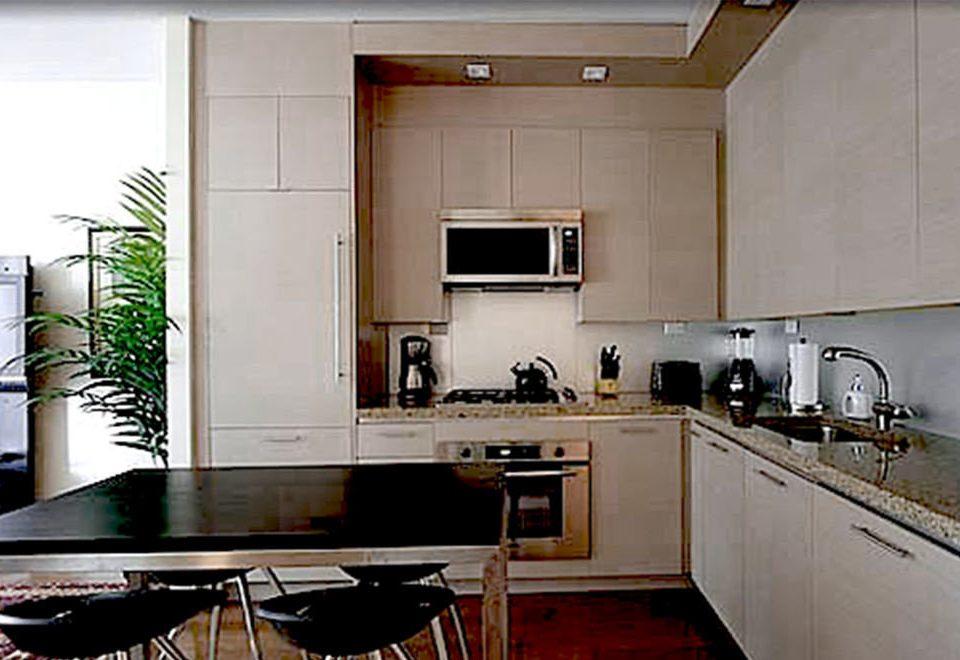 Kitchen property cabinetry home countertop cuisine classique cuisine cottage appliance kitchen appliance stove