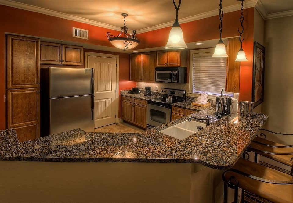 Kitchen property countertop home cabinetry hardwood cuisine classique cottage material stainless appliance steel