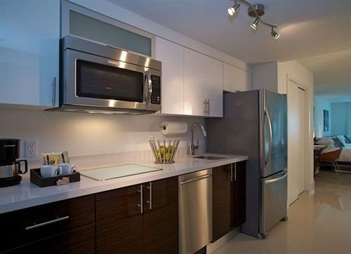 Kitchen property home cuisine classique hardwood appliance cabinetry countertop cottage kitchen appliance steel stainless stove microwave
