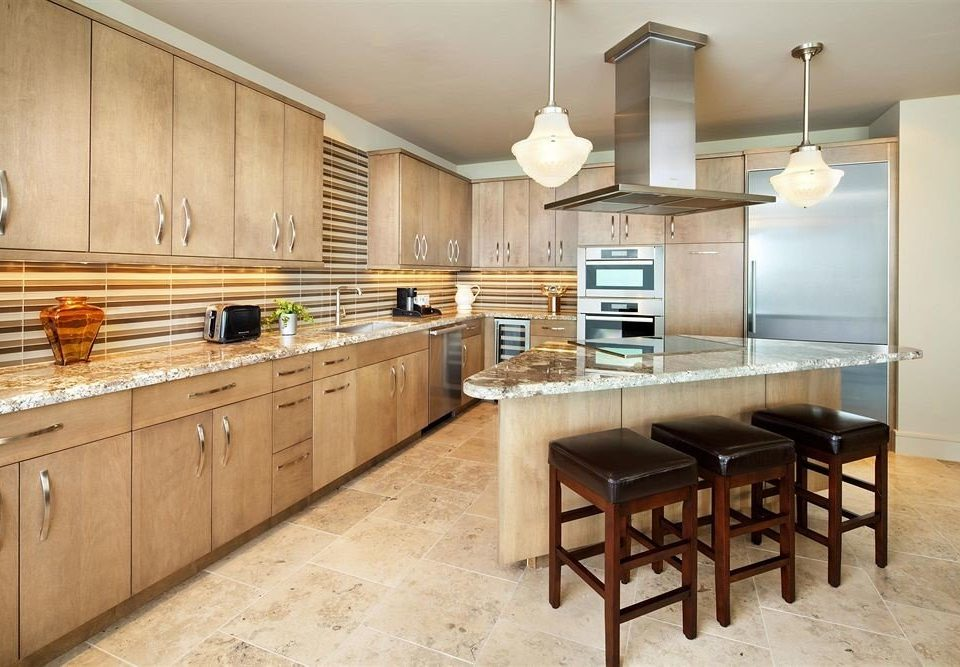 Kitchen property cabinetry countertop hardwood home cuisine classique cottage stainless cuisine farmhouse wood flooring food steel appliance