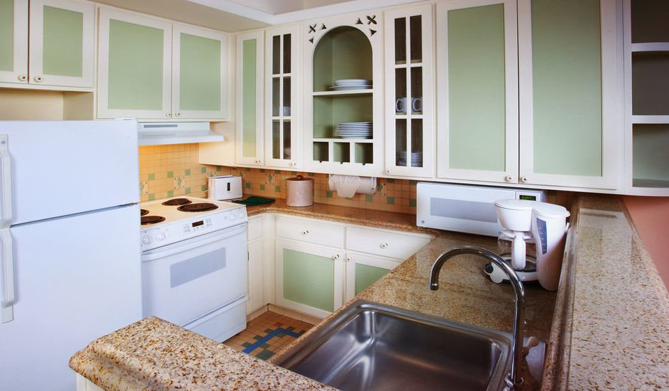 Kitchen property countertop home cabinetry cottage cuisine classique farmhouse appliance