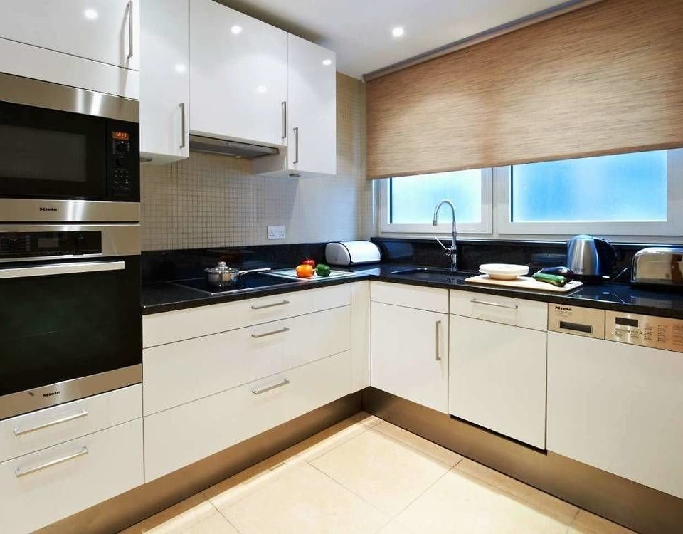 Kitchen property home cabinetry appliance countertop yacht counter kitchen appliance