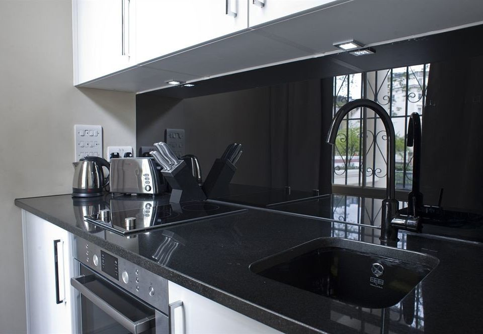 Kitchen property countertop home lighting cabinetry glass material kitchen appliance stove steel appliance stainless
