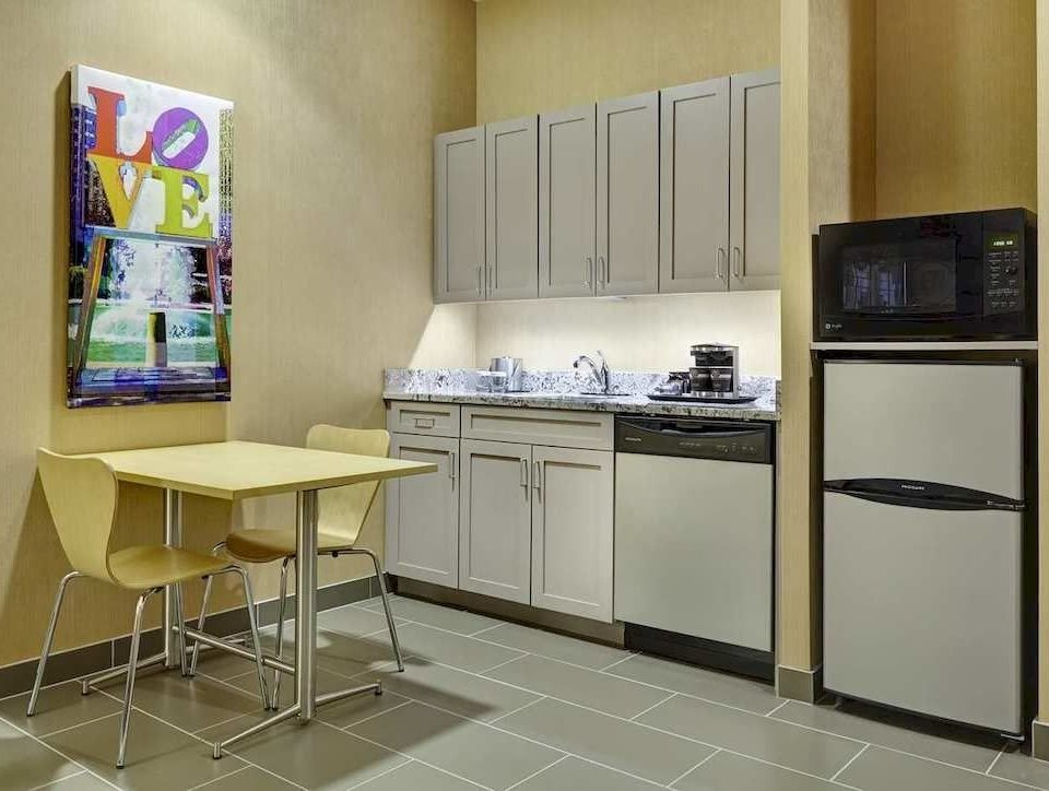 Kitchen property cabinetry home flooring appliance