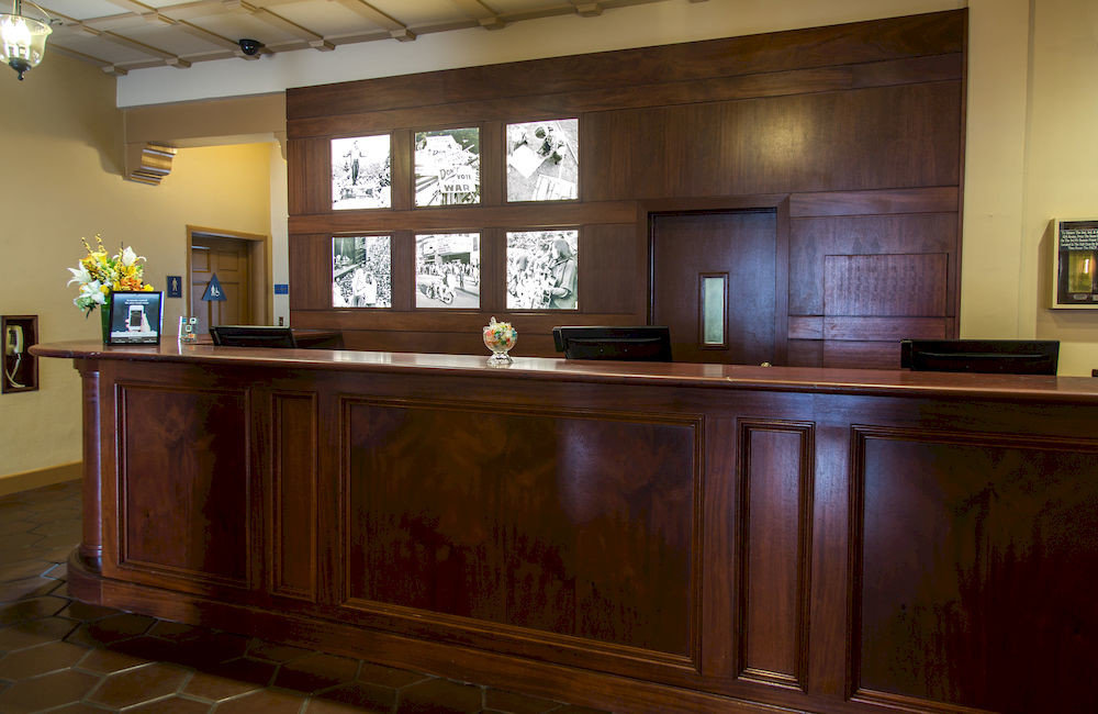 Kitchen cabinetry hardwood receptionist home recreation room appliance