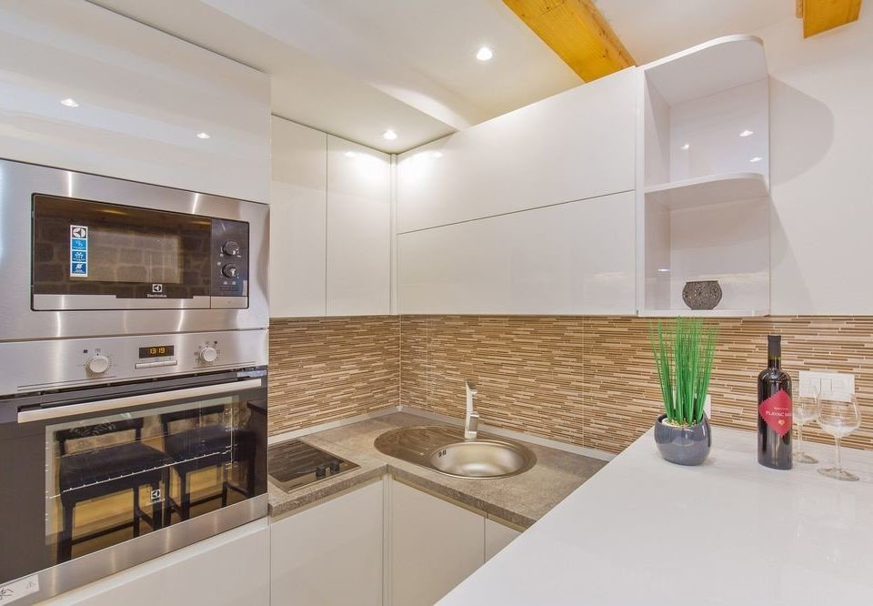 Kitchen property home counter condominium flooring living room appliance kitchen appliance