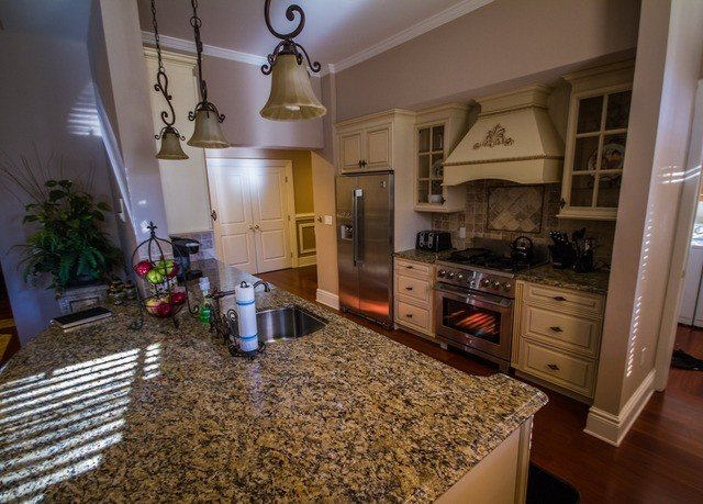 property Kitchen home countertop hardwood cottage living room farmhouse mansion flooring wood flooring appliance stainless