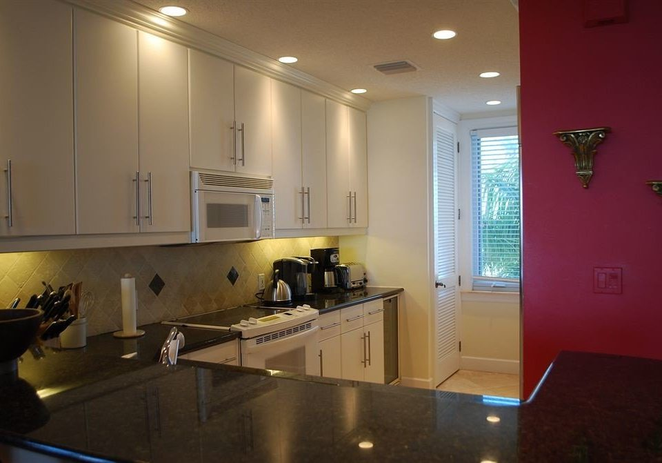 Kitchen property house home counter countertop lighting sink living room appliance kitchen appliance stove