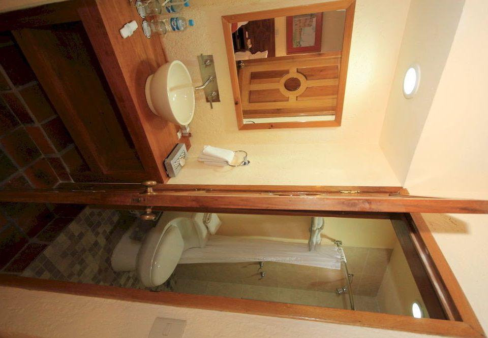 bathroom mirror property sink house toilet hardwood home cabinetry shelf art Kitchen cottage living room
